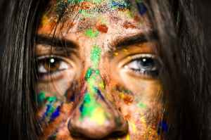 close up photo of woman with paint on face